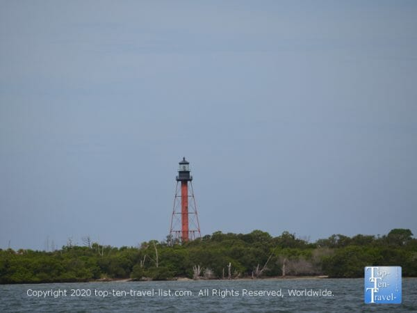 Anclote Island lighthouse seen from the Odyssey Dolphin cruise in Tarpon Springs, Florida