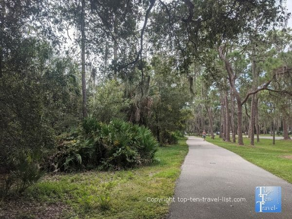 Shady bike trail at Lake Seminole Park in Largo, Florida