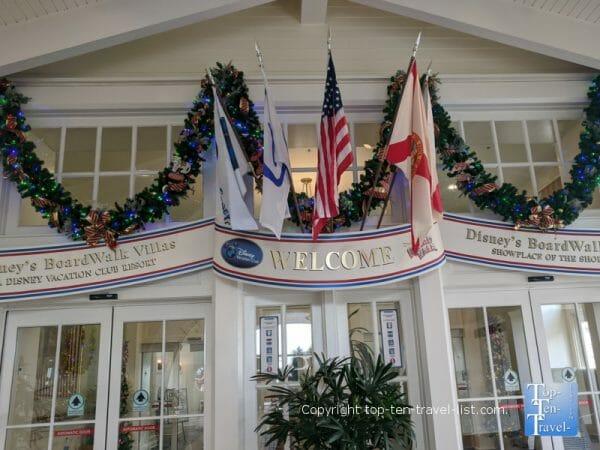 Festive Christmas garland at the entrance to Disney's Boardwalk Inn