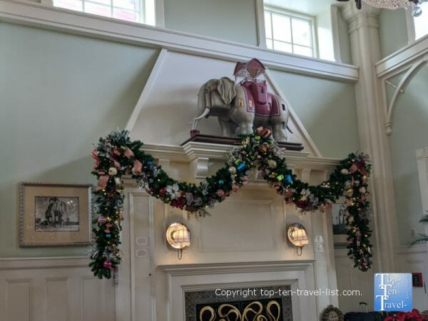 Festive garland around the fireplace for Christmas at Disney's Boardwalk Inn