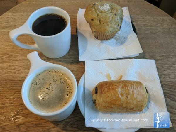 Americano, muffin, and chocolate croissant at Caffeine Roasters in Tampa, Florida
