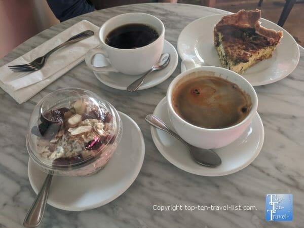 Americano, veggie quiche, and overnight oats at Belleair Coffee Company in Tampa Bay