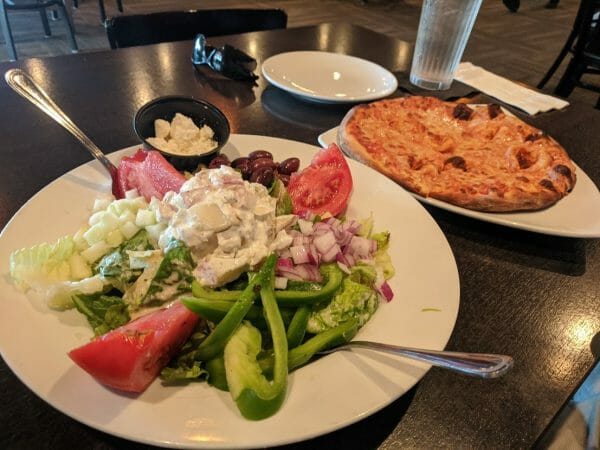 Greek salad and cheese pizza at Slyce in Madeira Beach, Florida