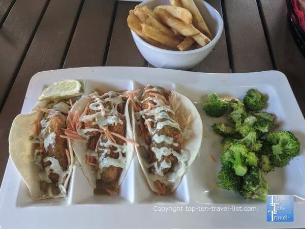 Fried avocado tacos with a side of broccoli at Salty's in Clearwater, Florida